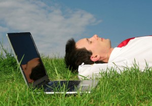 bigstockphoto_Businessman_Lying_On_The_Grass_1733065